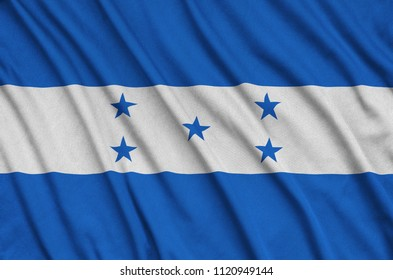 Honduras flag  is depicted on a sports cloth fabric with many folds. Sport team banner