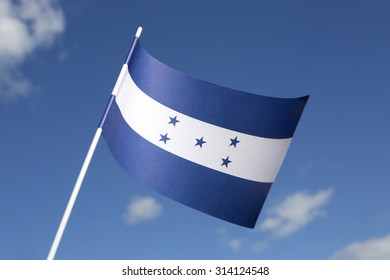 Honduras flag in front of a blue sky
