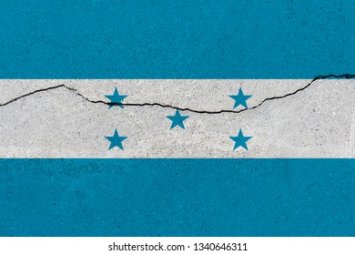 Honduras flag on concrete wall with crack. Patriotic grunge background. National flag of Honduras