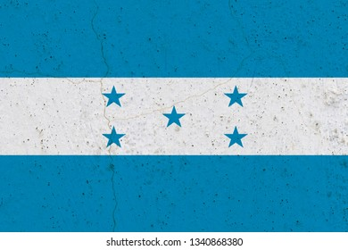 Honduras flag on concrete wall. Patriotic grunge background. National flag of Honduras