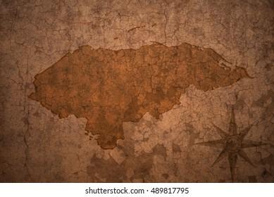honduras map on a old vintage crack paper background