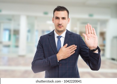 Honest trustworthy real estate agent making oath swear vow gesture on new apartment building lobby background