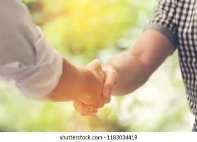 Honesty teamwork promise completion deal after make a hands shake. Completion Honesty Teamwork Concept. Hands of Honest Partner team shaking hands promise professional team make business agreement.