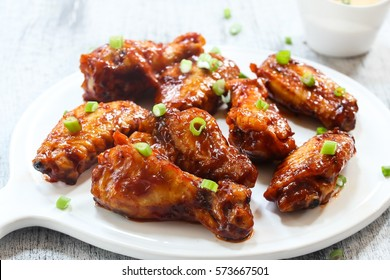 Honey Barbecue glazed chicken wings, selective focus