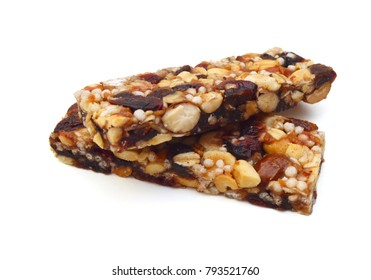 Honey bars with peanuts on white background