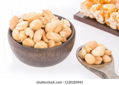 Honey bars with peanuts - white background.