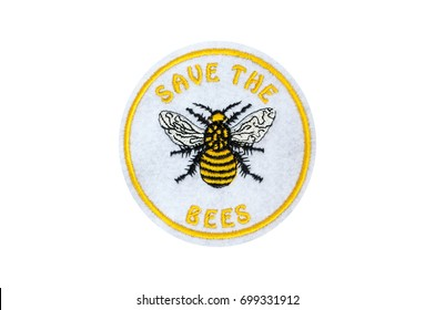a honey bee embroidered on a badge