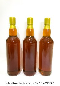 honey bee glass bottles and white background
