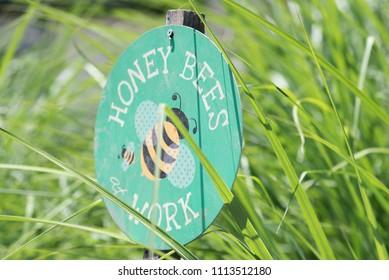 Honey Bees at Work Sign in Garden