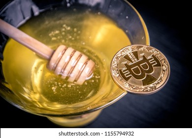 Honey and bitcoin close-up