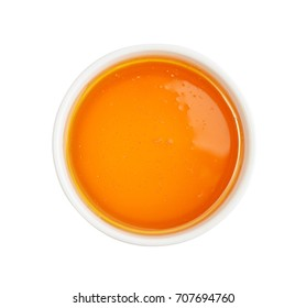 Honey in bowl isolated on white background, top view