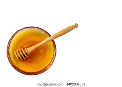 Honey in bowl with wood stick isolated on white background