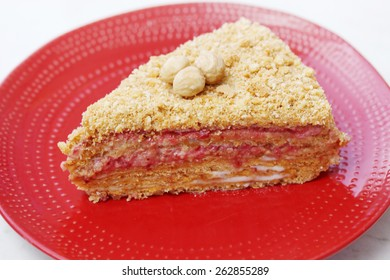 Honey cake with strawberry jam and nuts