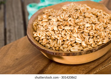 Honey coated puffed wheat breakfast cereal in a bowl