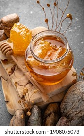 Honey comb and a jar of honey. A useful fortified bee product for health and beauty. Vegetarian dietary organic product. Beautiful still life.
