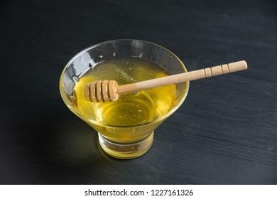 Honey cup close up on dark background