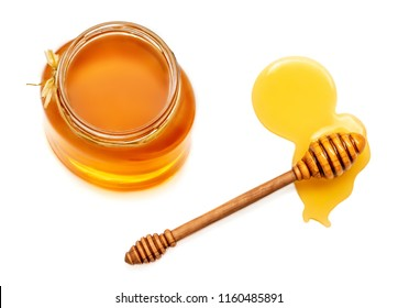 honey dipper and honey in jar isolated on white background. Natural bee Honey. Top view