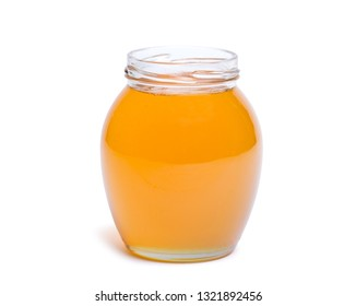 honey dipper and honey in jar on white background