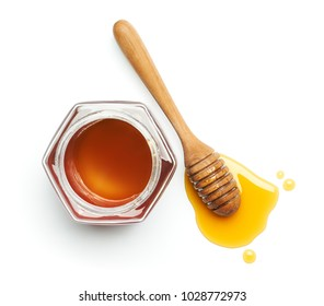 Honey dipper and jug over white background