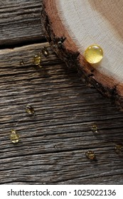 honey drops close-up on wooden boards and cross-section of pine trunk background