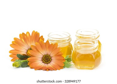 honey and flowers on white  background
