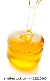 Honey flowing isolated on white background.