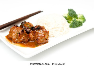 honey garlic meatballs with white rice and brocolli with a nice sauce