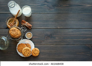 Honey ginger cookies with milk on a rustic background, selective focus