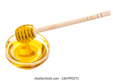 honey in a glass cup. spoon for honey in a cup. honey flows into a glass cup. honey in a glass cup on a white background