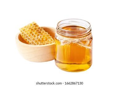 Honey in glass on white background