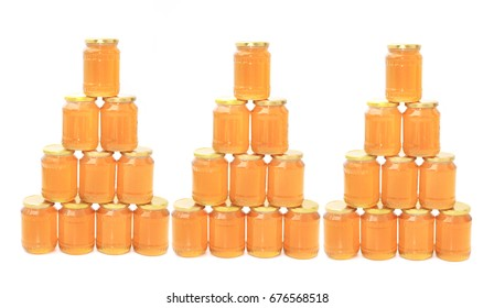 honey in glasses isolated on the white background
