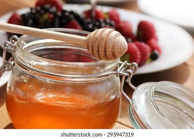 Honey glass,wooden dipper,fruits