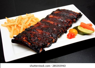 Honey Glazed Baby Back Ribs with Truffle Fries