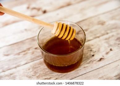 Honey, Honeycomb, Honey Bee on a wooden table