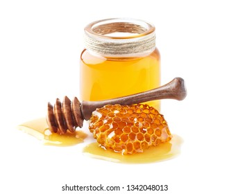 Honey and honeycomb with spoon