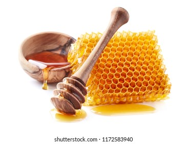 Honey with honeycomb and wooden plate