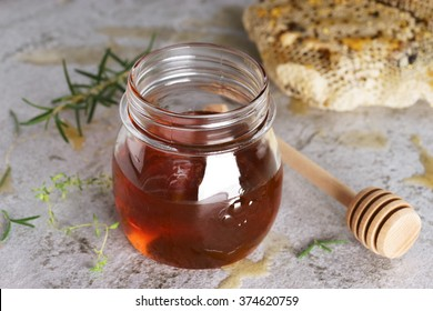 Honey in jar with herbs