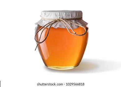 Honey in jar isolated on white background.
