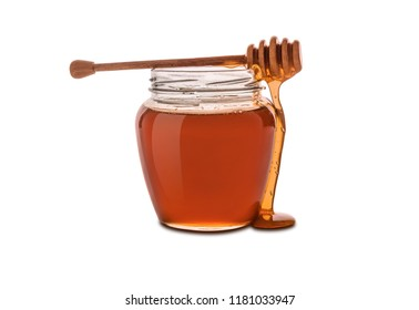 Honey in jar isolated on white background.