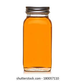 Honey in jar isolated on white background