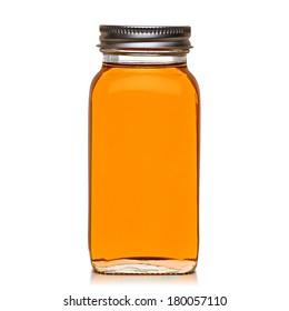Honey in jar on white background