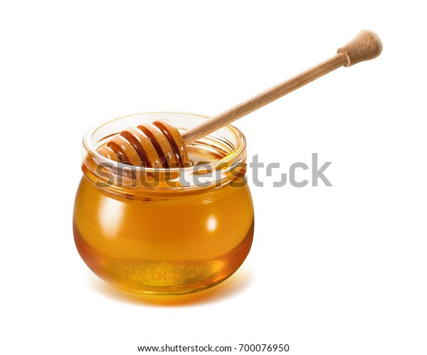 Honey jar with wooden dipper isolated on white background as package design element