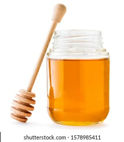 Honey in jar with a wooden stirrer on a white background. Isolated