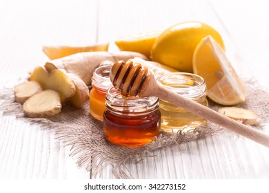 Honey, lemon and ginger on wooden table.healthy food.