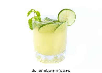 Honey lime drink cocktail with mint on white background