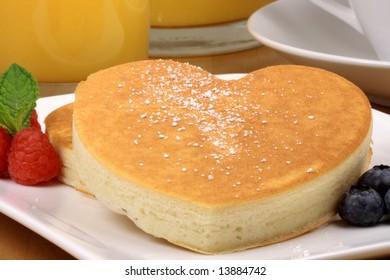 honey moon pancakes with fresh orange juice and berries