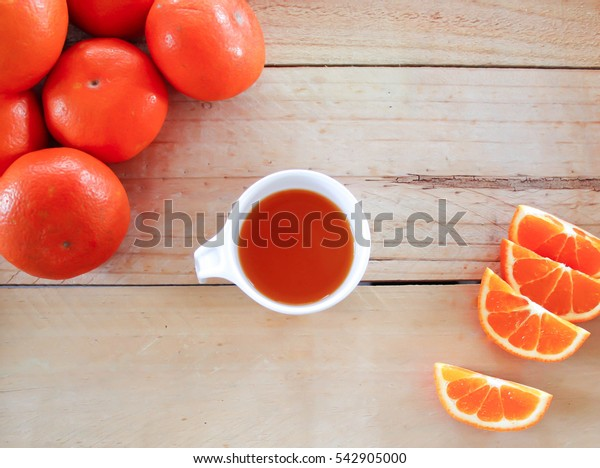Honey morcot orange and orange juice on the wood background