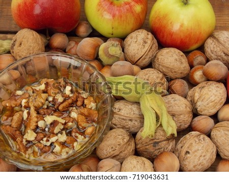 c6e5c2329ad9 Honey Nuts Apples On Table Stock Photo (Edit Now) 719043631 ...
