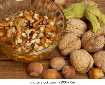 honey with nuts on the table