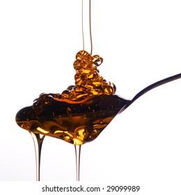 Honey piled onto spoon